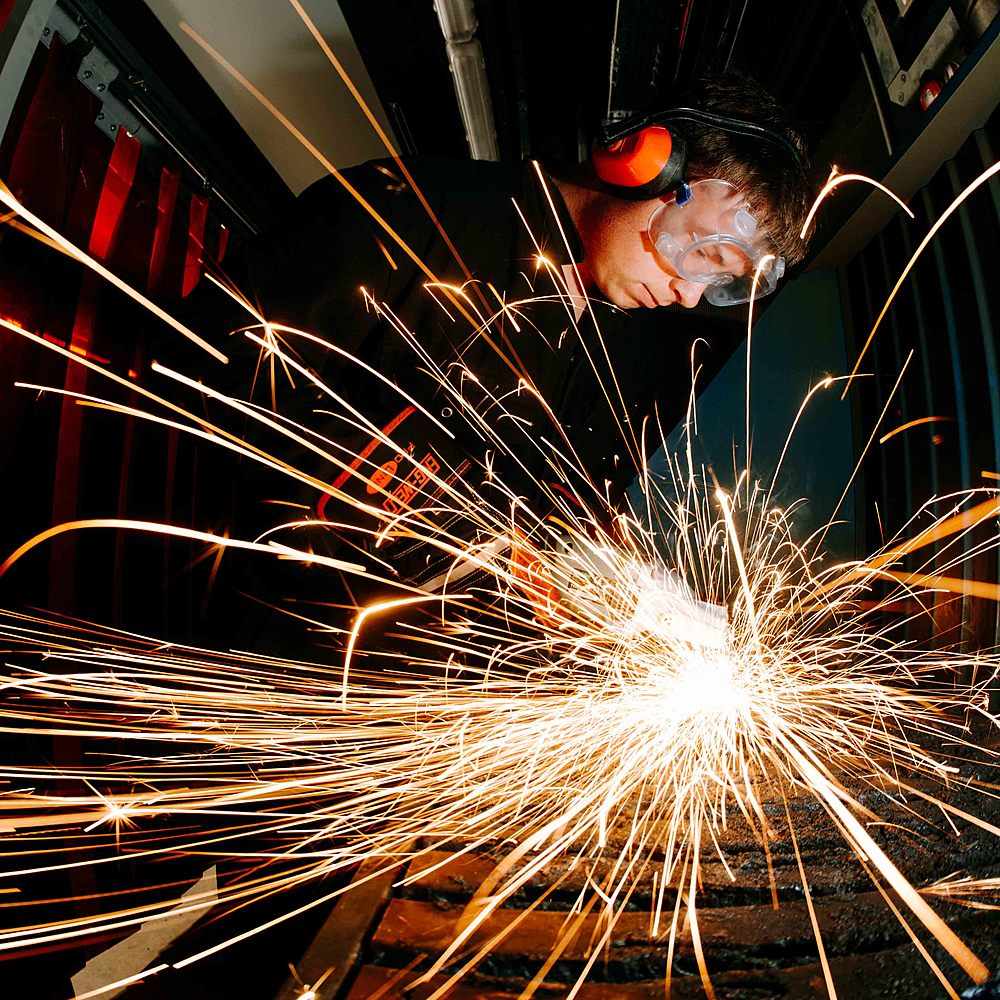 A student welding in Riseholme College's Engineering workshop