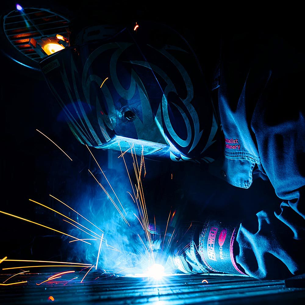 A student on an Engineering course welding in Riseholme College's workshop
