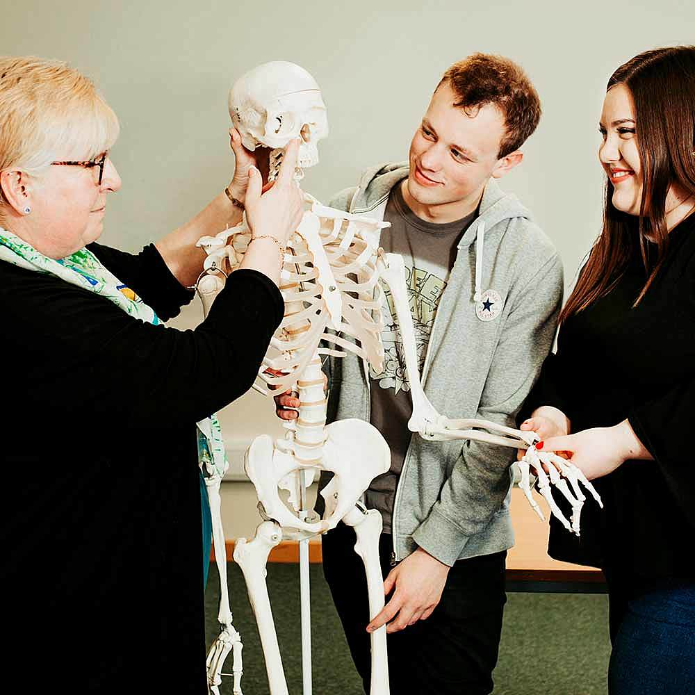 Health and Social Care students receive a demonstration on the human body using a skeleton at Riseholme College