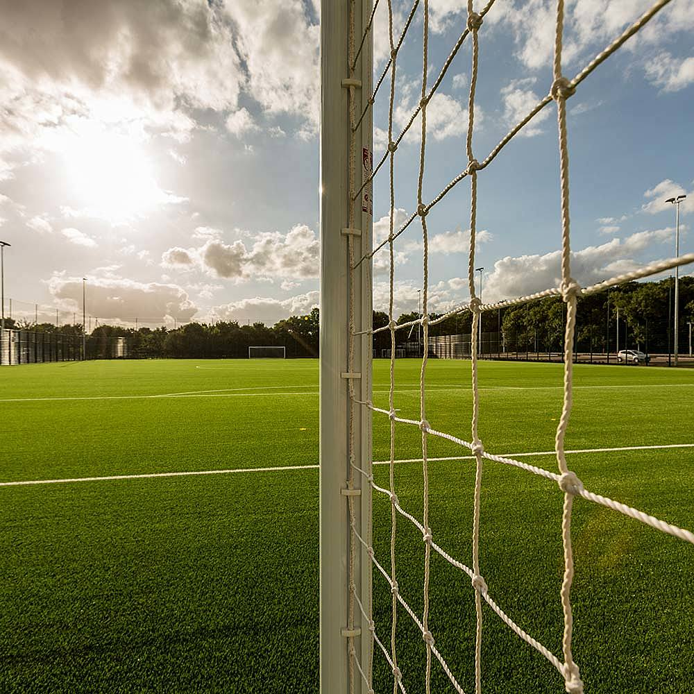 View of 3G sport pitch through a goal net at Riseholme College