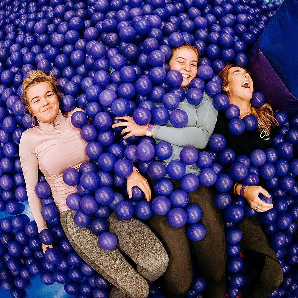 Girls from Riseholme College in ball pit at a student event